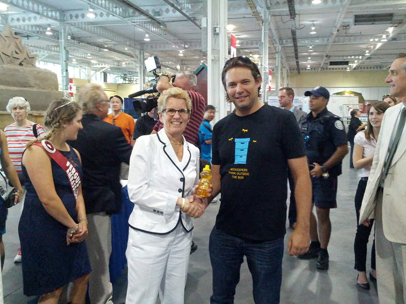 Daniel Szabo presented Wynne with local honey from Lilley Bee Apiaries in St. Catherines Ontario and a 100% pure beeswax rose candle from Szabo Queens